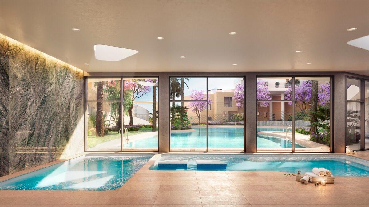 Render interior del spa de Allonbay Village con vistas a la piscina tipo playa gracias al gran ventanal que conecta visualmente las zonas de agua.