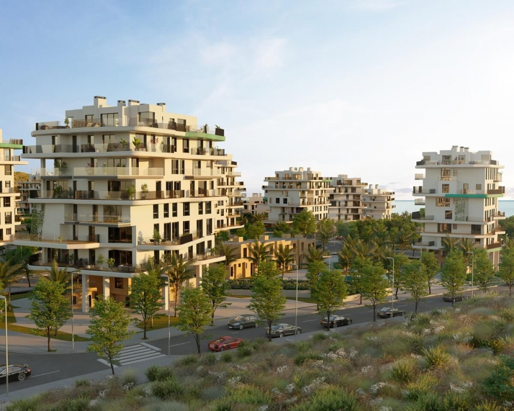 Render Allonbay Village Aster. Destacan las fachadas traseras con las coronas verdes y las vistas hacia el mar Mediterráneo.