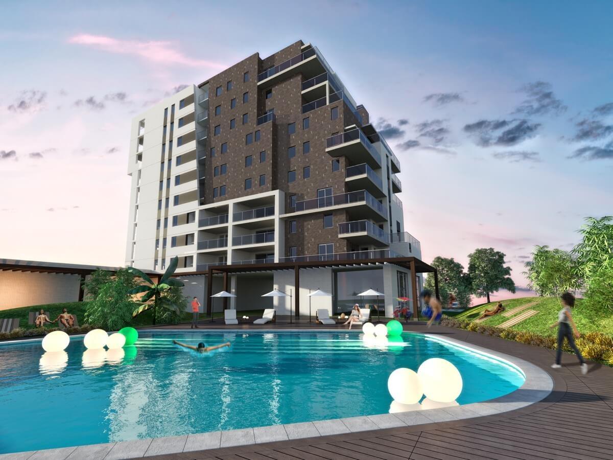 Render desde el interior de la urbanización del bloque y piscina.